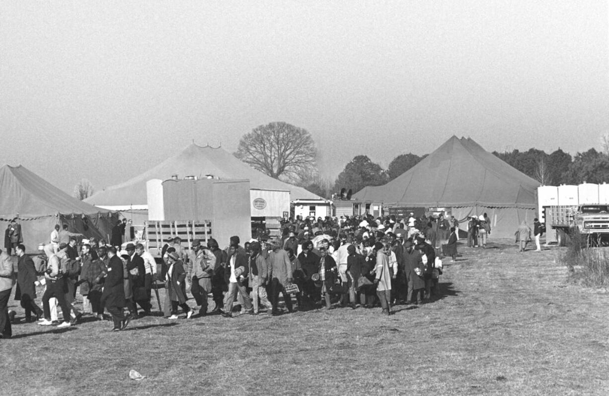 FILE - In this March 22, 1965, file photo, participants in the Selma-to-Montgomery voting rights march are shown at a campsite near Selma, Ala. A new assessment released by the National Trust for Historic Preservation in 2021 says four campsites used by marchers nearly 60 years earlier are in danger of being lost without efforts to save them.