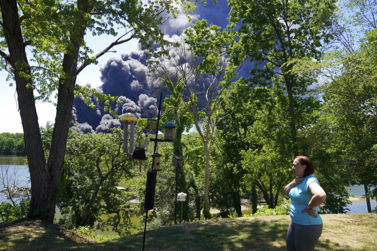 Jessica King looks at the smoke from a chemical plant fire in Rockton, Ill., from her backyard in South Beloit, Ill., Monday, June 14, 2021.