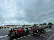Residents in low-lying areas of Hancock County move their vehicles, lawn mowers, ATVs and boats to higher ground in Waveland, Miss., as a tropical system approaches Friday, June 18, 2021.  Forecasters predict a tropical system will bring heavy rain, storm surge and coastal flooding to the U.S. Gulf Coast. The poorly organized disturbance was located Friday morning about 255 miles south of Morgan City, Louisiana.