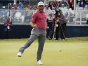 Jon Rahm reacts to making his birdie putt on the 18th green during the final round of the U.S. Open Golf Championship, Sunday in San Diego.