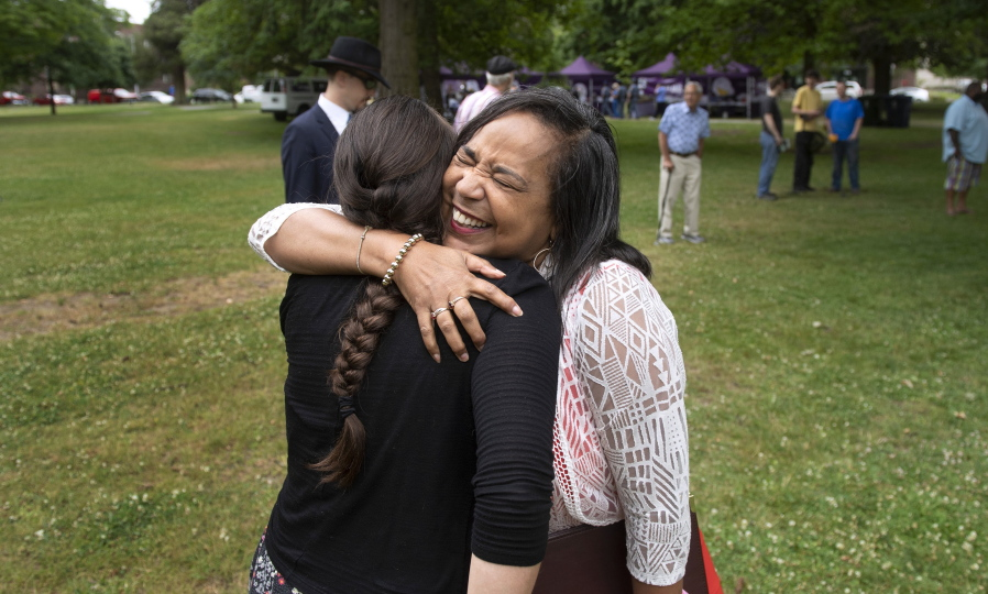 """Tacoma Mayor Victoria Woodards greets friends with hugs during the """"Welcome Back, Washington"""" celebration Wednesday at Wright Park in Tacoma."""
