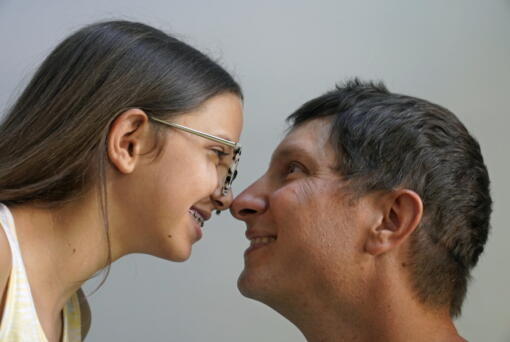 Cecilia Shaffette and her father Rhett Shaffette touch noses as they pose for a portrait in their home in Carriere, Miss., Wednesday, June 16, 2021. The 12-year-old is thriving, eight months after getting a portion of her father's liver. She received the transplant after nearly losing her life to internal bleeding.