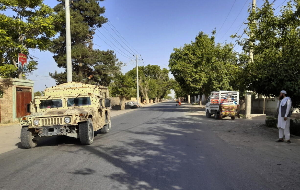 An Afghan army Humvee patrols in Kunduz city, north of Kabul, Afghanistan, Monday, June 21, 2021. Taliban fighters took control of a key district in Afghanistan's northern Kunduz province Monday and encircled Kunduz, the provincial capital, police said.