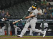 Oakland Athletics' Matt Olson hits a two-run single during the seventh inning of the team's baseball game against the Seattle Mariners, Tuesday, June 1, 2021, in Seattle. (AP Photo/Ted S.