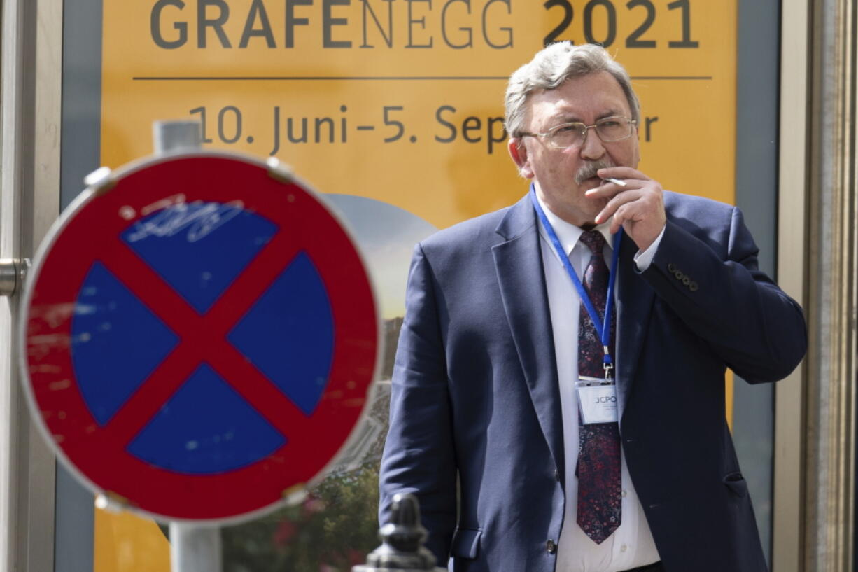 Russia's Governor to the International Atomic Energy Agency (IAEA), Mikhail Ulyanov, smokes a cigarette near the 'Grand Hotel Vienna' where where closed-door nuclear talks take place in Vienna, Austria, Saturday, June 12, 2021.