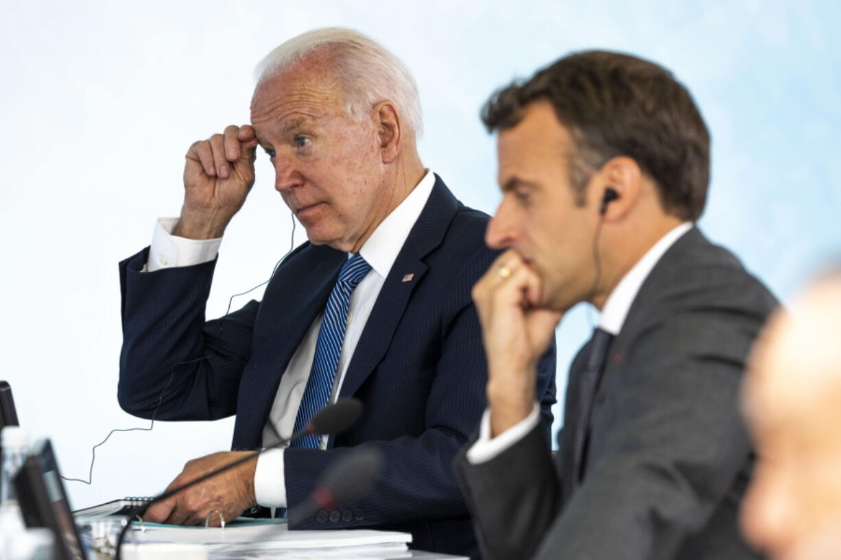 President Joe Biden talks with French President Emmanuel Macron during the final session of the G-7 summit in Carbis Bay, England, Sunday, June 13, 2021.