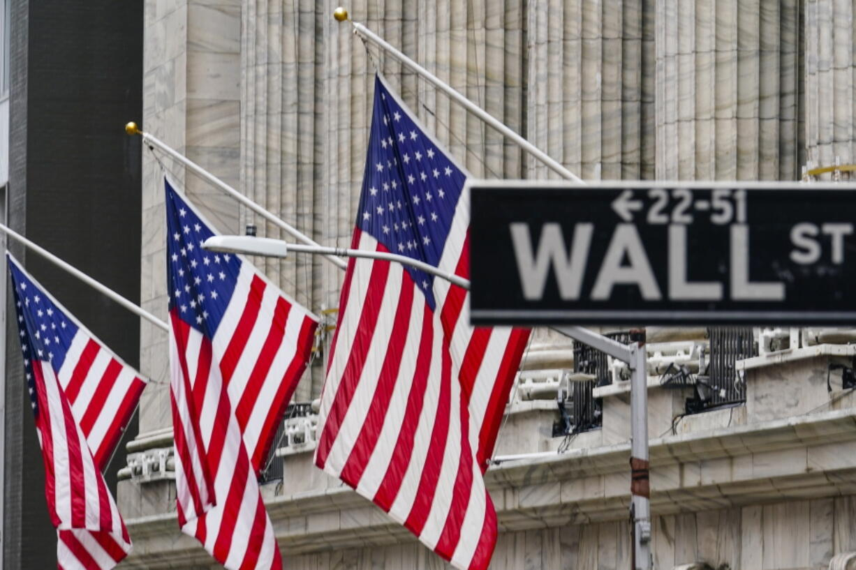 FILE - American flags hang outside of the New York Stock Exchange, in this Tuesday, Feb. 16, 2021, file photo. The White House believes it has an ally in the bond markets to make the case that inflation isn't an economic threat.