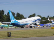The final version of the 737 MAX, the MAX 10, passes other 737 MAX planes as it takes off from Renton Airport in Renton, Wash., on its first flight Friday, June 18, 2021. The plane will fly over Eastern Washington and then land at Boeing Field.  (Ellen M.