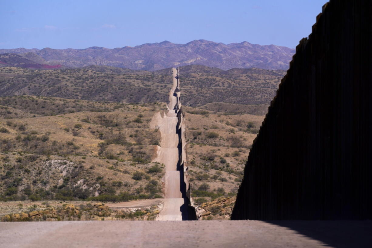 A new border wall stretches along the landscape near Sasabe, Ariz., on Wednesday, May 19, 2021. (AP Photo/Ross D.