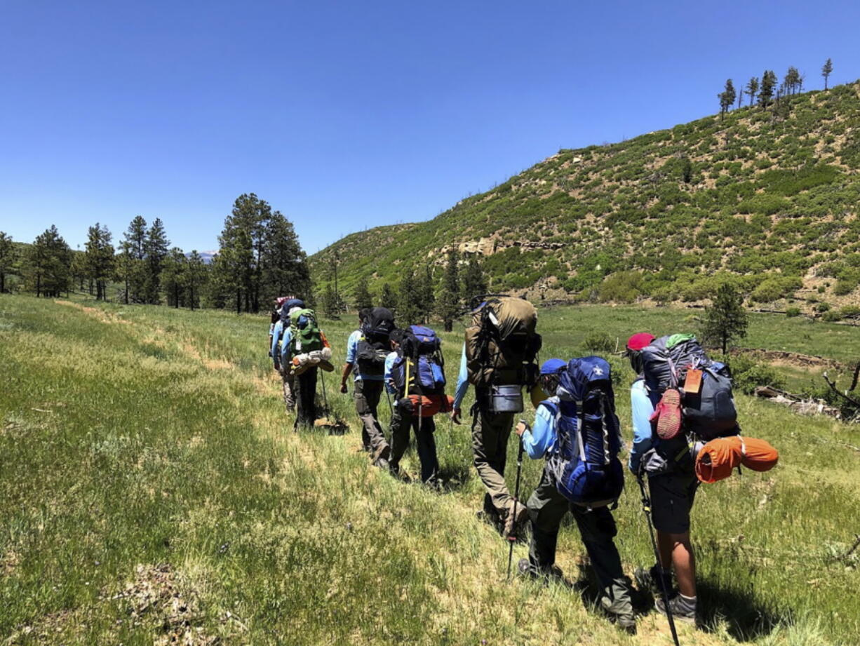 In this June 10, 2021 photo provided by Barry Bedlan, members of Troop 298 of Frisco, Texas are among the first to embark a 12-day trek across the Philmont Scout Ranch, outside Cimarron, N.M. Boy Scout and Girl Scouts' leadership say their summer camps are full, special events are sold out, and they're expecting many thousands of families - some new to scouting, some who left during the pandemic - to sign up now that activities are occurring in-person rather than virtually.