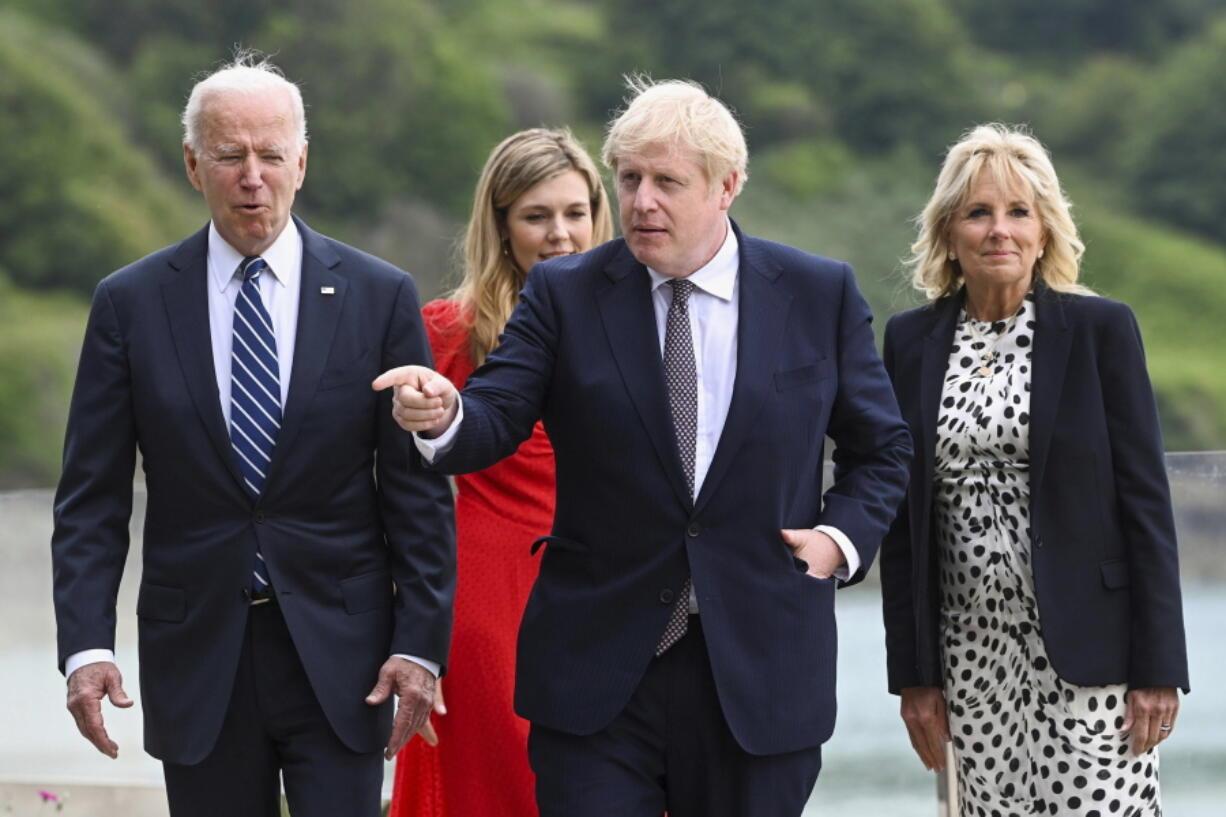 From left: US President Joe Biden, Carrie Johnson, Britain's Prime Minister Boris Johnson and First Lady Jill Biden walk outside Carbis Bay Hotel in Cornwall, Britain, Thursday June 10, 2021.