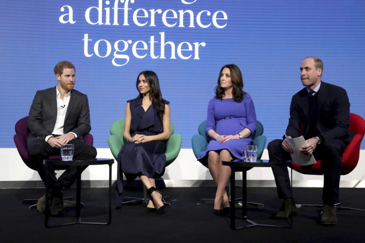 FILE - In this file photo dated Wednesday Feb. 28, 2018, Britain's Prince William and Kate, Duchess of Cambridge, right, sit with Prince Harry, left, and his fiancee Meghan Markle, as they attend the first annual Royal Foundation Forum in London. Under the theme 'Making a Difference Together', the event will showcase programmes run or initiated by The Royal Foundation.  Links now seem strained between the brothers as William sits in London defending the royal family from allegations of racism and insensitivity.