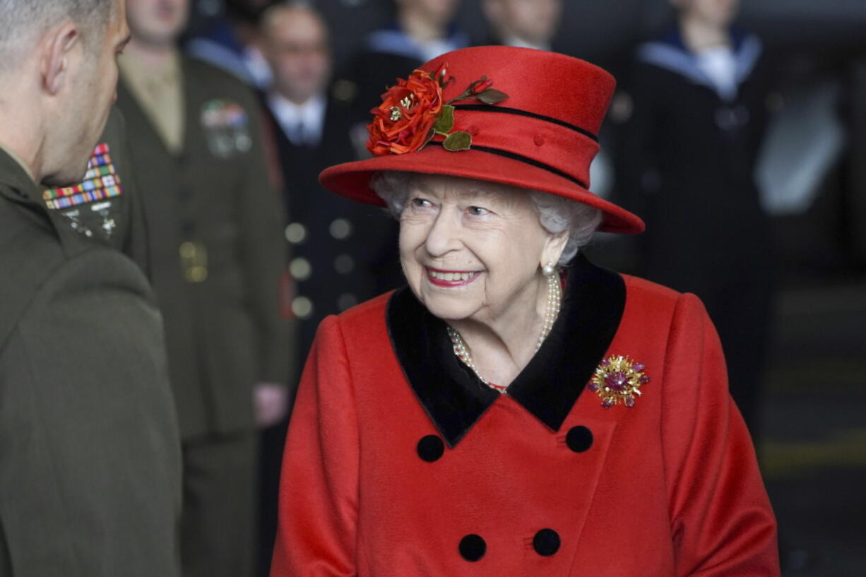 Britain's Queen Elizabeth II visits the HMS Queen Elizabeth at HM Naval Base, ahead of the ship's maiden deployment, in Portsmouth, England, Saturday May 22, 2021. HMS Queen Elizabeth will be leading a 28-week deployment to the Far East that Prime Minister Boris Johnson has insisted is not confrontational towards China.