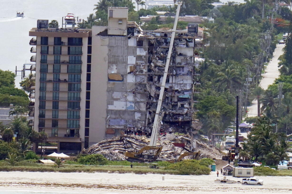 Workers search in the rubble at the Champlain Towers South Condo, Saturday, June 26, 2021, in Surfside, Fla. One hundred fifty-nine people were still unaccounted for two days after Thursday's collapse, which killed at least four.
