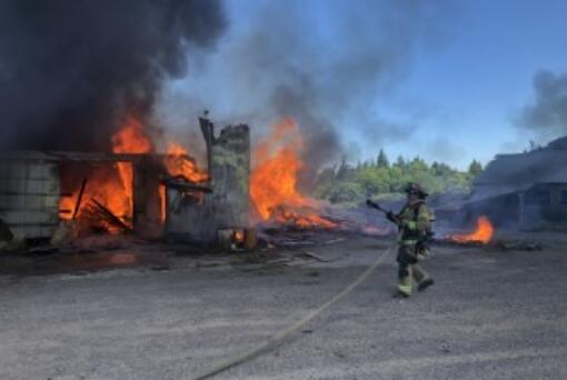 Clark-Cowlitz Fire Rescue crews battle a barn fire Wednesday afternoon at 23115 N.W. Hillhurst Road in Ridgefield. No one was injured. The barn, once part of Kennedy dairy farm, was being demolished to make way for the Kennedy Farm housing development.