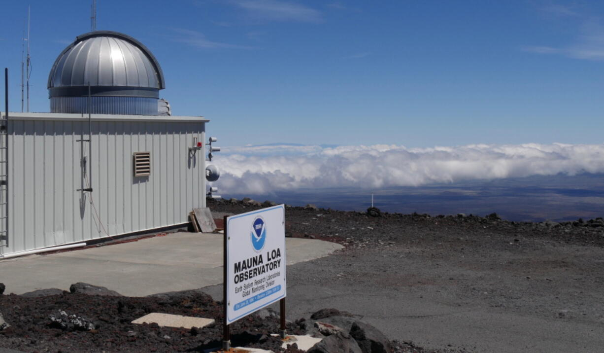 The Mauna Loa Atmospheric Baseline Observatory, atop Hawaii's largest mountain in order to sample air free of local pollution. Heat-trapping carbon dioxide levels in the air peaked in May 2021, scientists reported Monday.