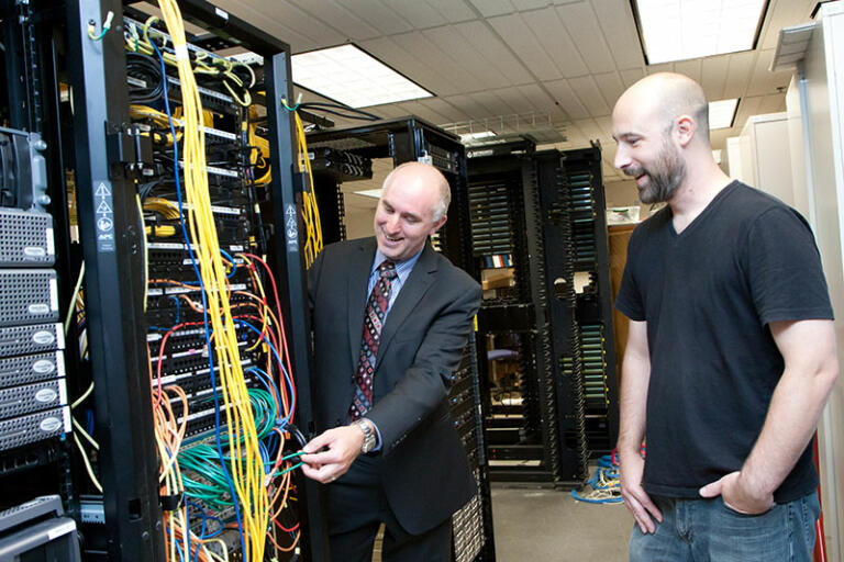 Clark College Network Technology professor Dwight Hughes shows a student server hardware in the college's lab. Powerful, enterprise-level servers power the virtual lab student access in class and from home. Clark College/Jenny Shadley
