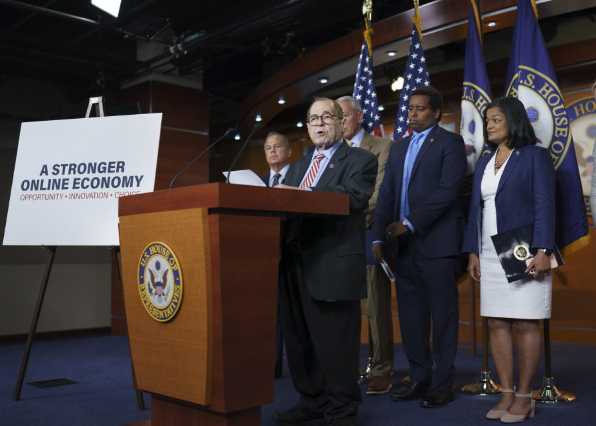 House Judiciary Committee Chair Jerrold Nadler, D-N.Y., joined by, from left, Rep. David Cicilline, D-R.I., chairman of the antitrust subcommittee, Rep. Ken Buck, R-Colo., the ranking member of the antitrust subcommittee, Rep. Joe Neguse, D-Colo., and Rep. Pramila Jayapal, D-Wash., chair of the Congressional Progressive Caucus, speaks to reporters about antitrust bills to be introduced at the Capitol in Washington, Wednesday, June 16, 2021. (AP Photo/J.