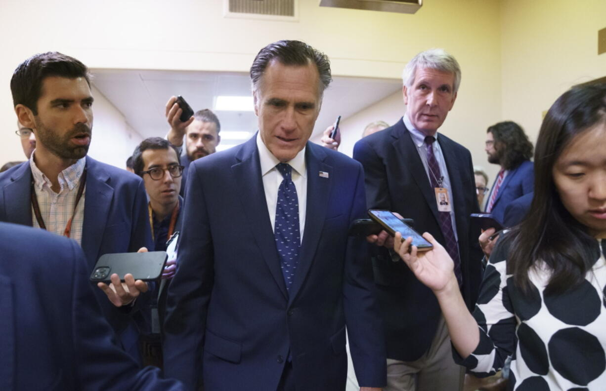 Sen. Mitt Romney, R-Utah, is surrounded by reporters as he walks to the Senate chamber for votes, at the Capitol in Washington, Thursday, June 10, 2021. Sen. Romney is working with a bipartisan group of 10 senators negotiating an infrastructure deal with President Joe Biden. (AP Photo/J.