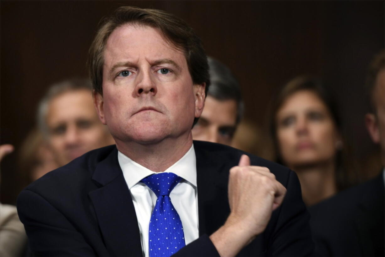 FILE - In this Sept. 27, 2018, file photo, then-White House counsel Don McGahn listens as Supreme court nominee Brett Kavanaugh testifies before the Senate Judiciary Committee on Capitol Hill in Washington. After years of trying, the House Judiciary Committee is set to question McGahn on June 4, 2021, two years after House Democrats originally sought his testimony as part of investigations into former President Donald Trump.
