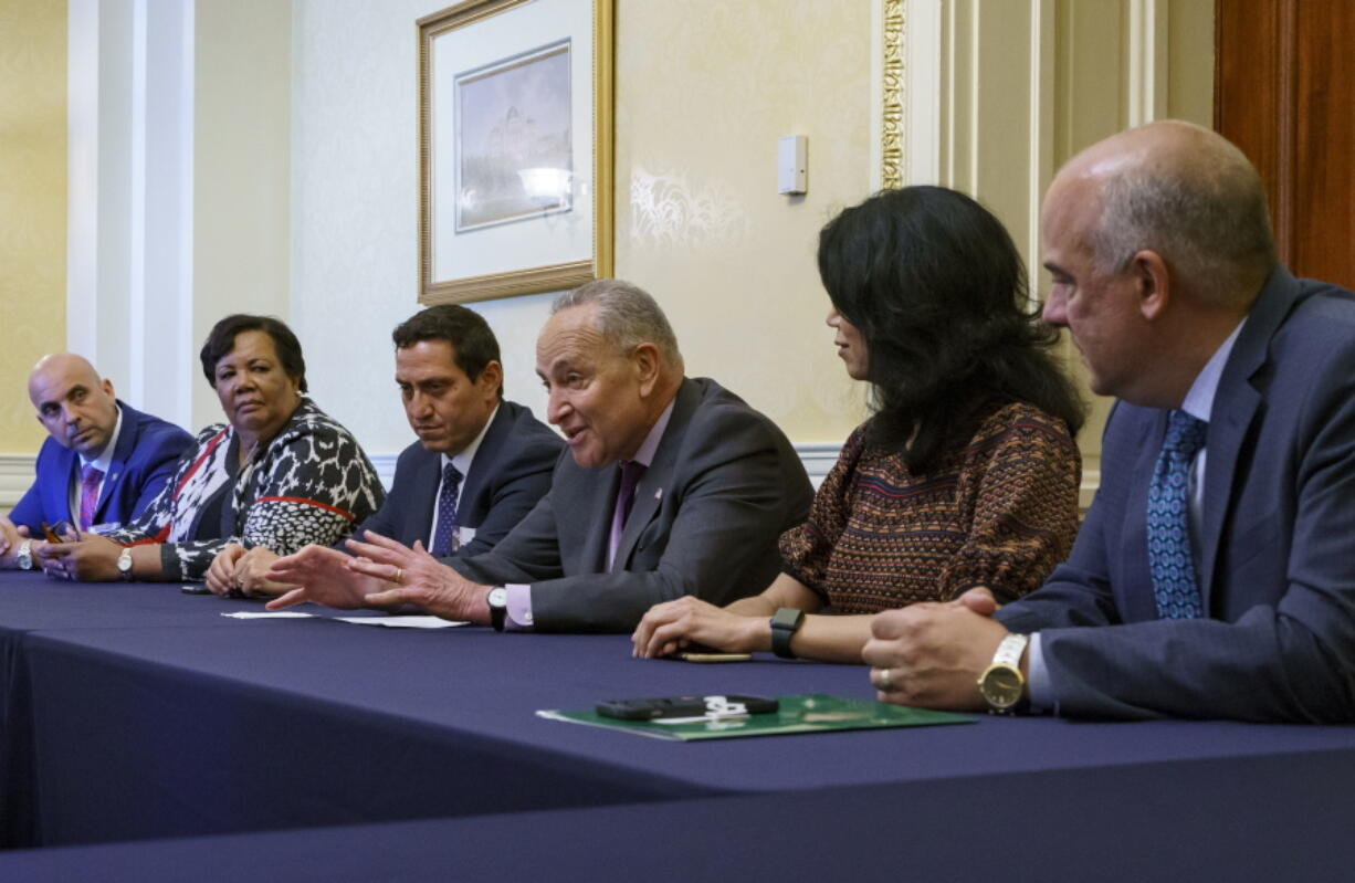 Senate Majority Leader Chuck Schumer, D-N.Y., is flanked by Texas Rep. Trey Martinez Fischer of San Antonio, left, and Texas Sen. Carol Alvarado of Houston, as he meets with Texas Democratic lawmakers to discuss voting rights, at the Capitol in Washington, Tuesday, June 15, 2021. Two weeks ago the Democrats walked out of the Texas House of Representatives to block passage of a new restrictive voting law. (AP Photo/J.