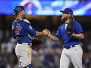 Chicago Cubs relief pitcher Craig Kimbrel, right, celebrates with catcher Willson Contreras after the final out for a combined no-hitter after a baseball game against the Los Angeles Dodgers in Los Angeles, Thursday, June 24, 2021. The Cubs won 4-0.