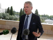 """FILE - In this Thursday, May 27, 2021 file photo, Finland's Foreign Minister Pekka Haavisto speaks with the media in Lisbon. A European Union envoy says Ethiopia's leaders told him in closed-door talks earlier this year that """"they are going to wipe out the Tigrayans for 100 years."""" The envoy, Pekka Haavisto, Finland's foreign minister, says such an aim """"looks for us like ethnic cleansing."""" Haavisto spoke in a question-and-answer session Tuesday, June 15 with a European Parliament committee."""