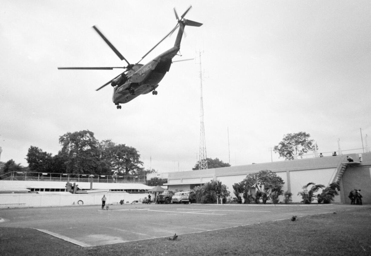FILE - In this April 29, 1975, file photo the helicopter zone at the U.S. Embassy in Saigon, Vietnam, showing last minute evacuation of authorized personnel and civilians. With U.S. and NATO forces under a Sept. 11, 2021, deadline to leave Afghanistan, many are recalling that desperate, hasty exodus as they urge the Biden administration to evacuate thousands of Afghans who worked as interpreters or otherwise helped U.S. military operations there in the past two decades.