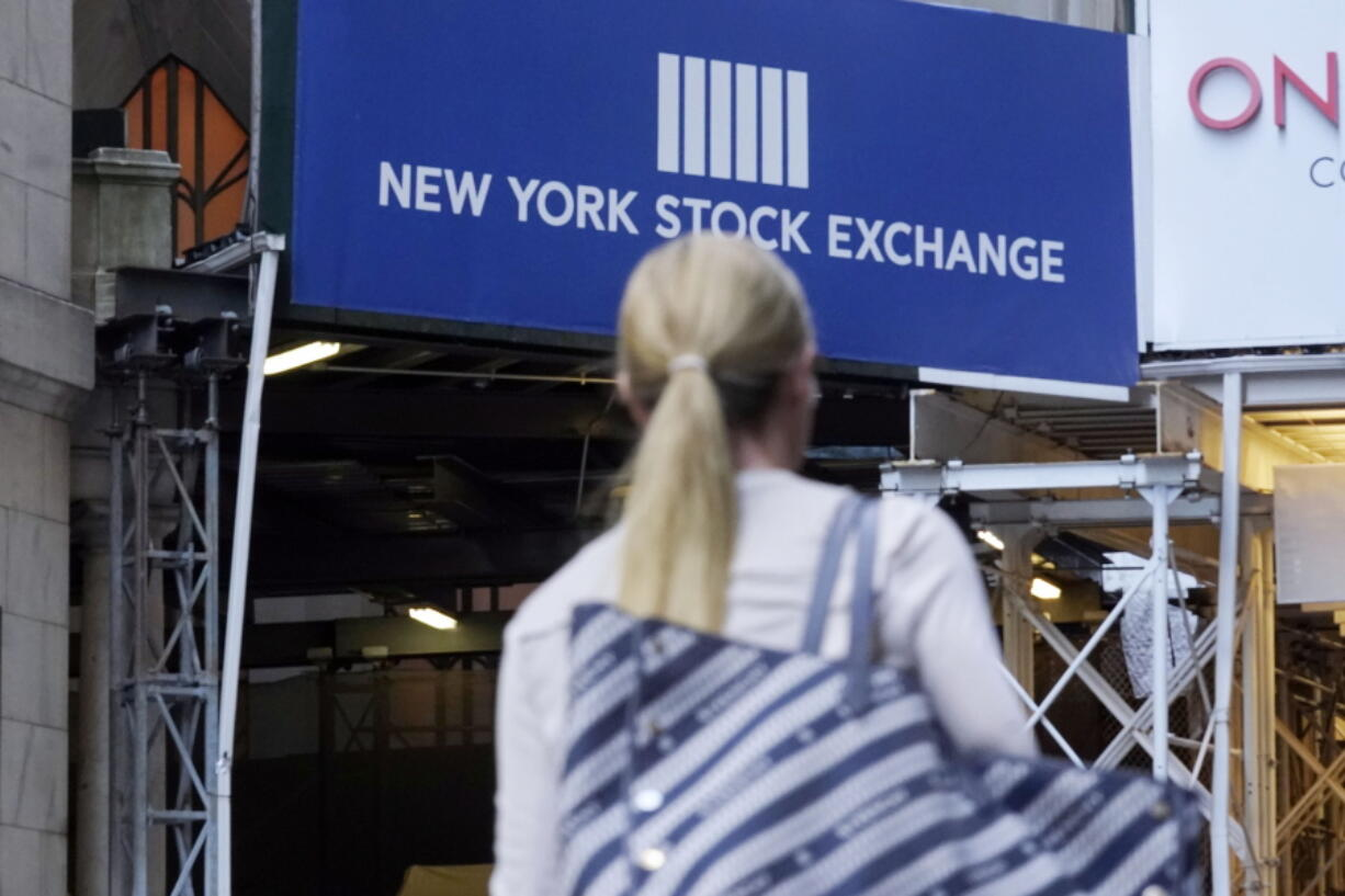A woman passes an entrance of the New York Stock Exchange, Wednesday, June 16, 2021. Stocks are opening higher on Wall Street, continuing an upturn this week that has brought the S&P 500 back to the record high level it reached a week and a half ago. The benchmark index was up 0.6% in the early going Thursday, June 24.