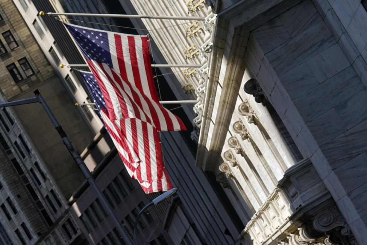 U.S. flags fly from the facade of the New York Stock Exchange, Monday, June 7, 2021. Stocks are opening mostly higher on Wall Street as gains for Big Tech companies offset weakness in banks and other parts of the market. The S&P 500 edged up 0.1 percent in the early going Wednesday, June 9.