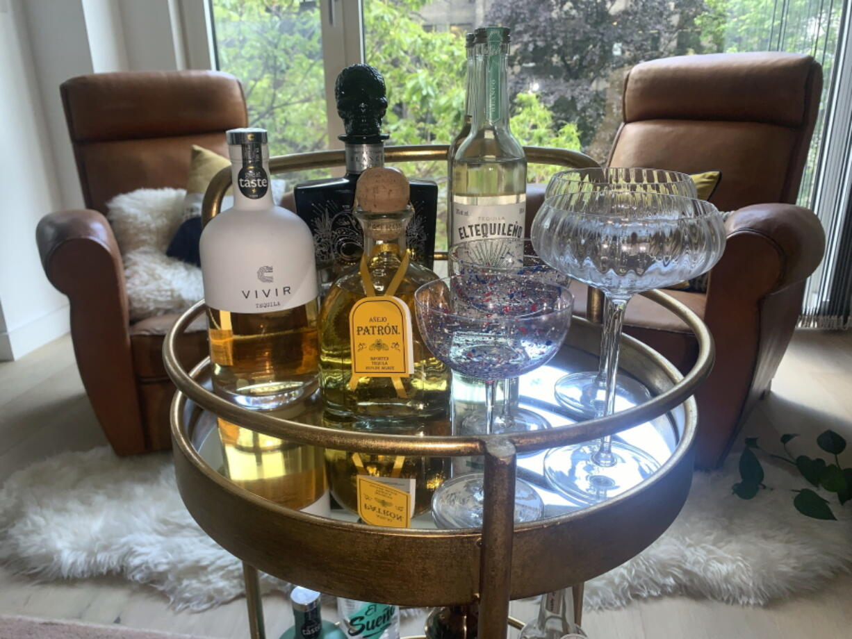 Several tequila brands are displayed in London. Today's premium tequilas are changing perceptions about the drink.