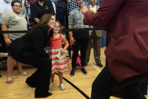 Vice President Kamala Harris leans in for a photograph with Stella Quatrini, after Harris spoke about the child tax credit at Brookline Memorial Recreation Center, Monday June 21, 2021, in Pittsburgh.