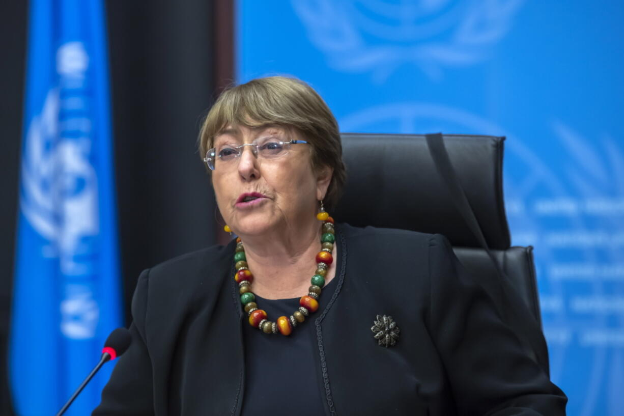 """FILE - In this Wednesday, Dec. 9, 2020 file photo Michelle Bachelet, UN High Commissioner for Human Rights, speaks during a press conference at the European headquarters of the United Nations in Geneva, Switzerland. In a landmark report launched after the killing of George Floyd in the United States, Bachelet on Monday June 28, 2021, is urging countries worldwide to do more to help end discrimination, violence and systemic racism against people of African descent and """"make amends"""" to them, including through reparations."""
