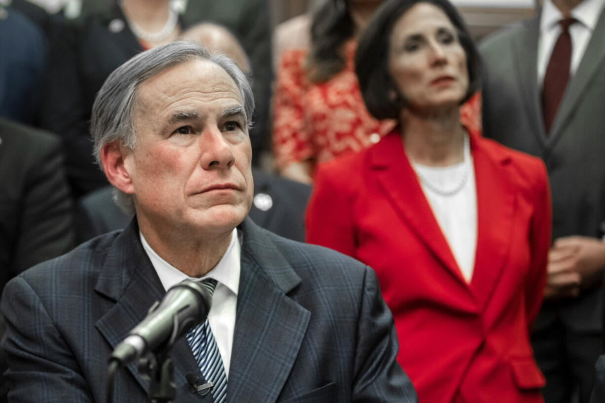"""Gov. Greg Abbott speaks during a press conference on details of his plan for Texas to build a border wall and provide $250 million in state funds as a """"down payment."""", Wednesday, June 16, 2021 in Austin, Texas. (Ricardo B."""