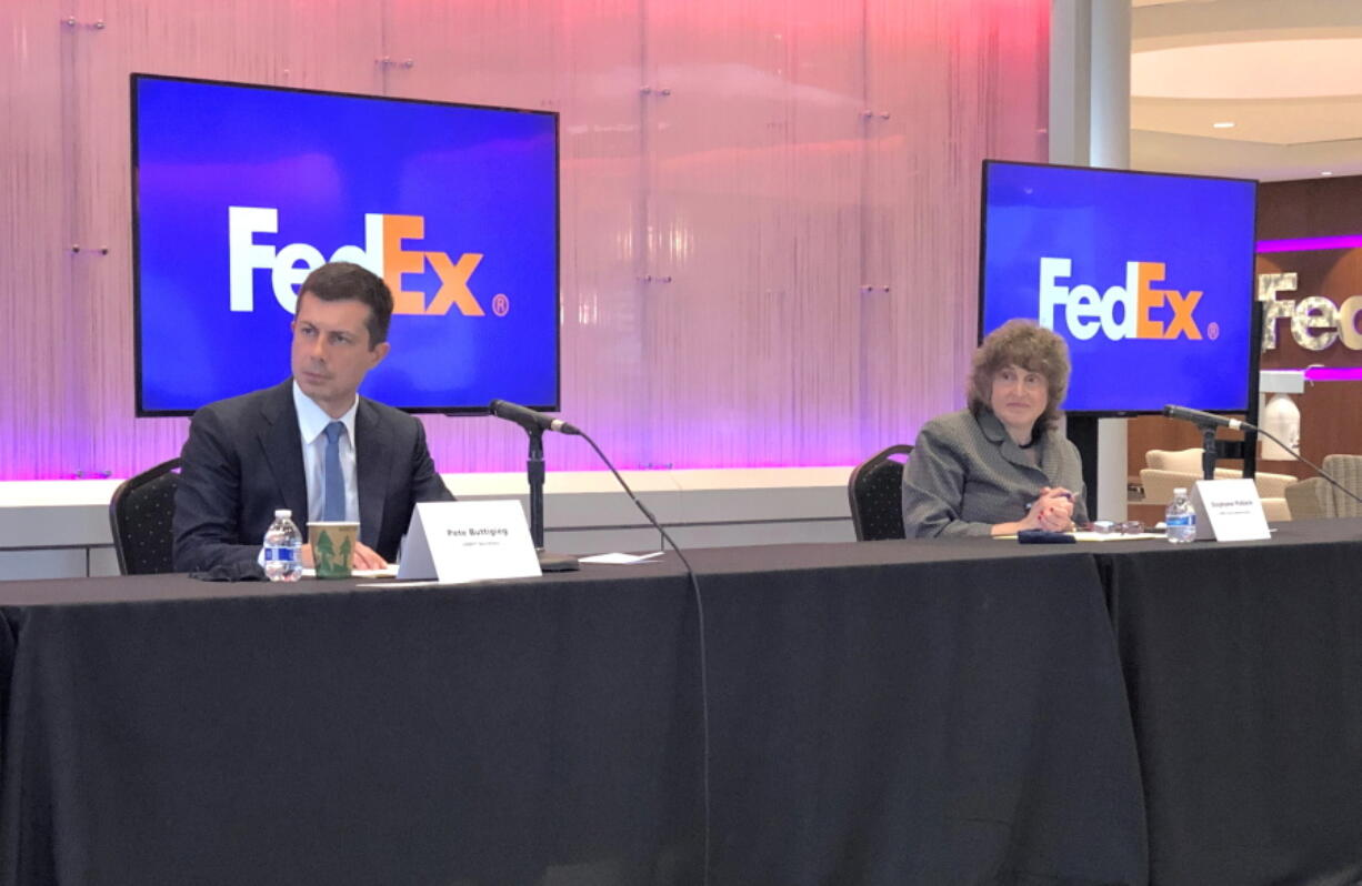 U.S. Department of Transportation Secretary Pete Buttigieg, left, and Acting Administrator for the Federal Highway Administration Stephanie Pollack listen to a speaker during a discussion at a FedEx Corp. facility about the closure of the Interstate 40 bridge on Thursday, June 3, 2021, in Memphis, Tenn.