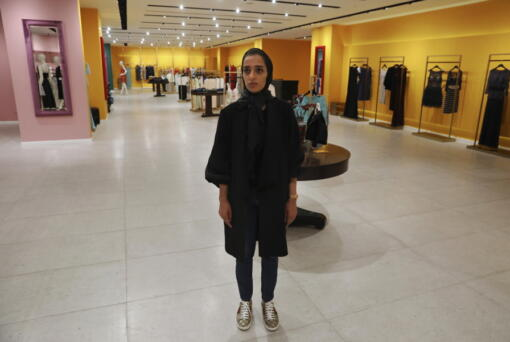 """Nasrin Hassani, a 34-year-old dressmaker, poses for a photo in a women's clothing store at Tehran Mall shopping center, in Tehran, Iran, Wednesday, June 9, 2021. Iranians this week are preparing to vote in -- or perhaps boycott -- a presidential election that many fear will only underscore their powerlessness to shape the country's fate. """"We have reached a point now that we wish we could return to where we were five and six years ago ... even if we can't have things improved,"""" lamented Hassani."""