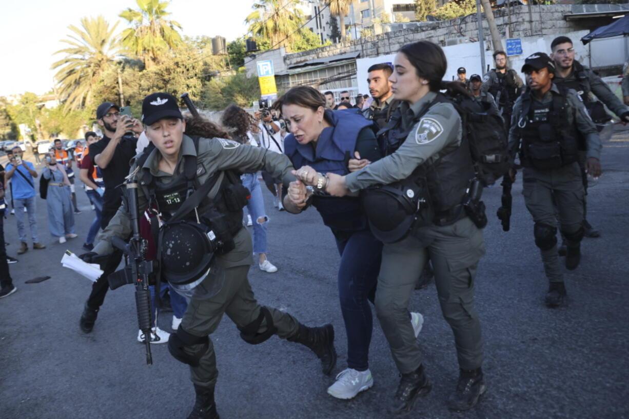 Israeli forces arrest Al Jazeera journalist, Givara Budeiri, during a protest in the east Jerusalem neighborhood of Sheikh Jarrah, Saturday, June 5, 2021.