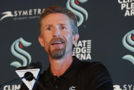 New Seattle Kraken Head Coach Dave Hakstol listens during a news conference, Thursday, June, 24, 2021 in Seattle. The Kraken hired Hakstol as head coach of the expansion franchise that will begin its first NHL hockey season in the fall.  It's his second NHL head-coaching job after three plus seasons with the Philadelphia Flyers from 2015-19.