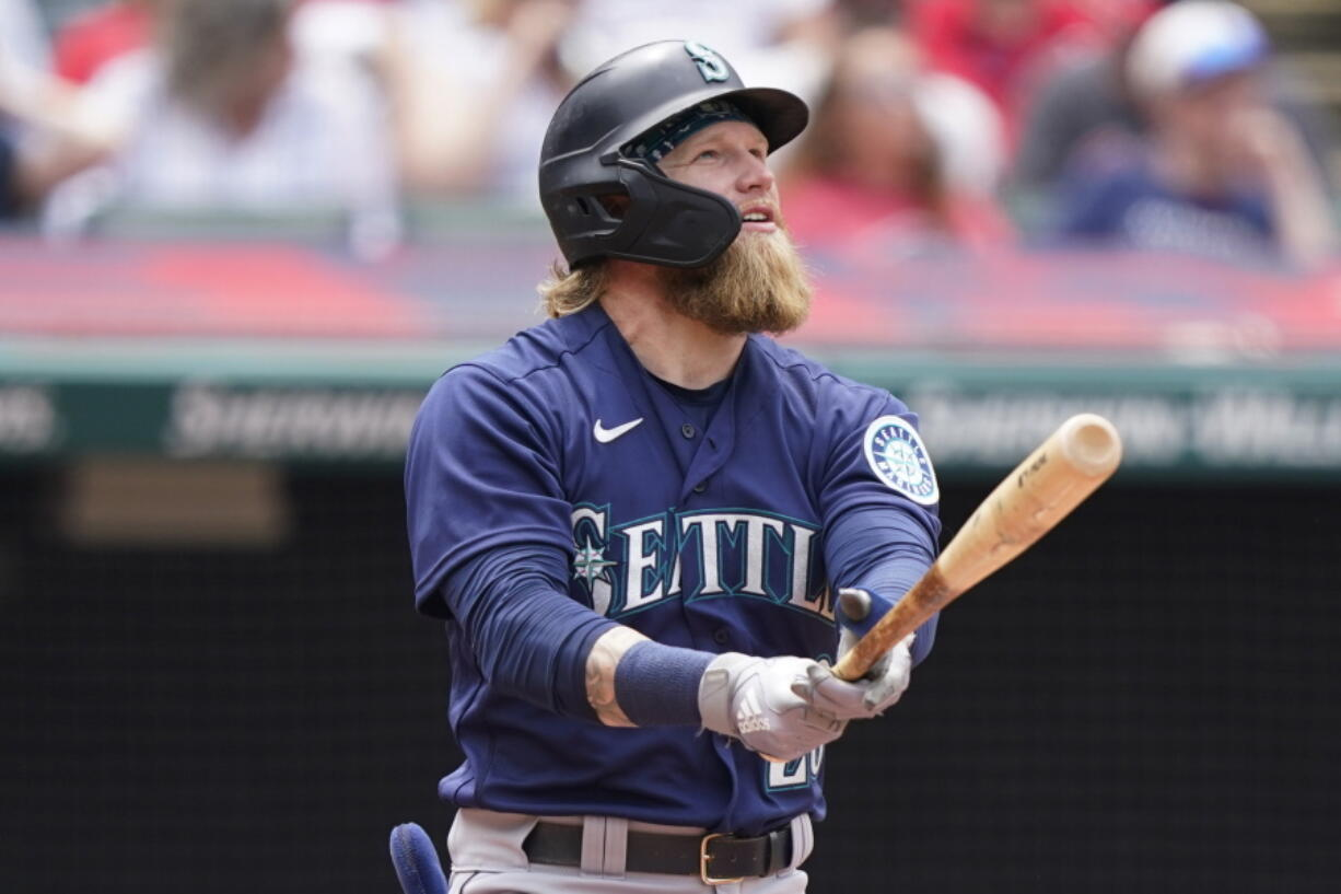 Seattle Mariners' Jake Fraley watches his ball after hitting a two-run home run in the fourth inning of a baseball game against the Cleveland Indians, Sunday, June 13, 2021, in Cleveland.