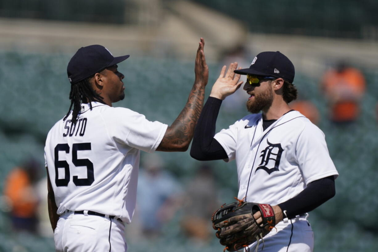Detroit Tigers relief pitcher Gregory Soto (65) greets left fielder Eric Haase after the team's 8-3 win over the Seattle Mariners in a baseball game, Thursday, June 10, 2021, in Detroit.