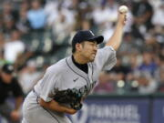 Seattle Mariners starting pitcher Yusei Kikuchi, of Japan, throws against the Chicago White Sox during the first inning of a baseball game in Chicago, Friday, June 25, 2021. (AP Photo/Nam Y.