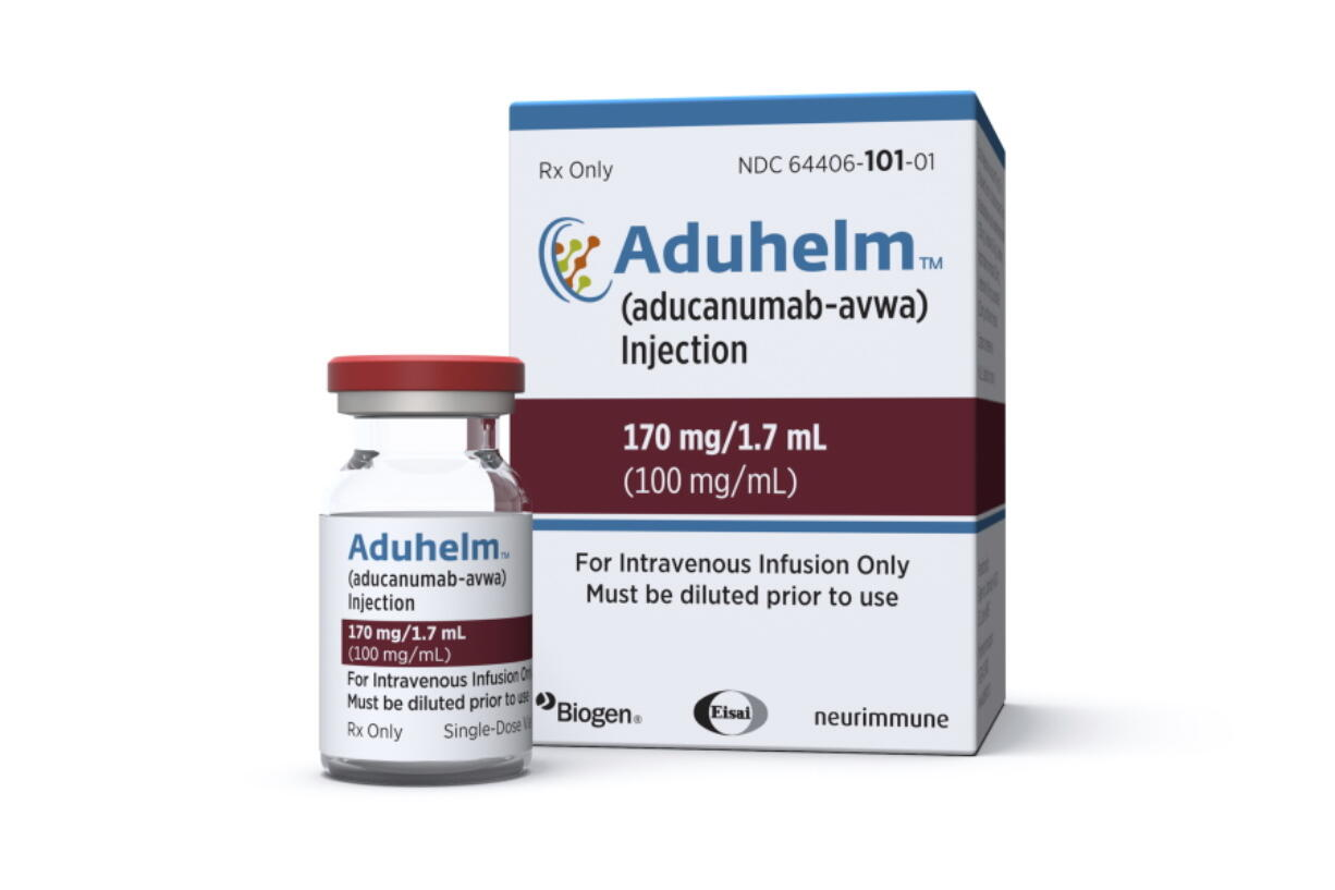 This image provided by Biogen on Monday, June 7, 2021 shows a vial and packaging for the drug Aduhelm.