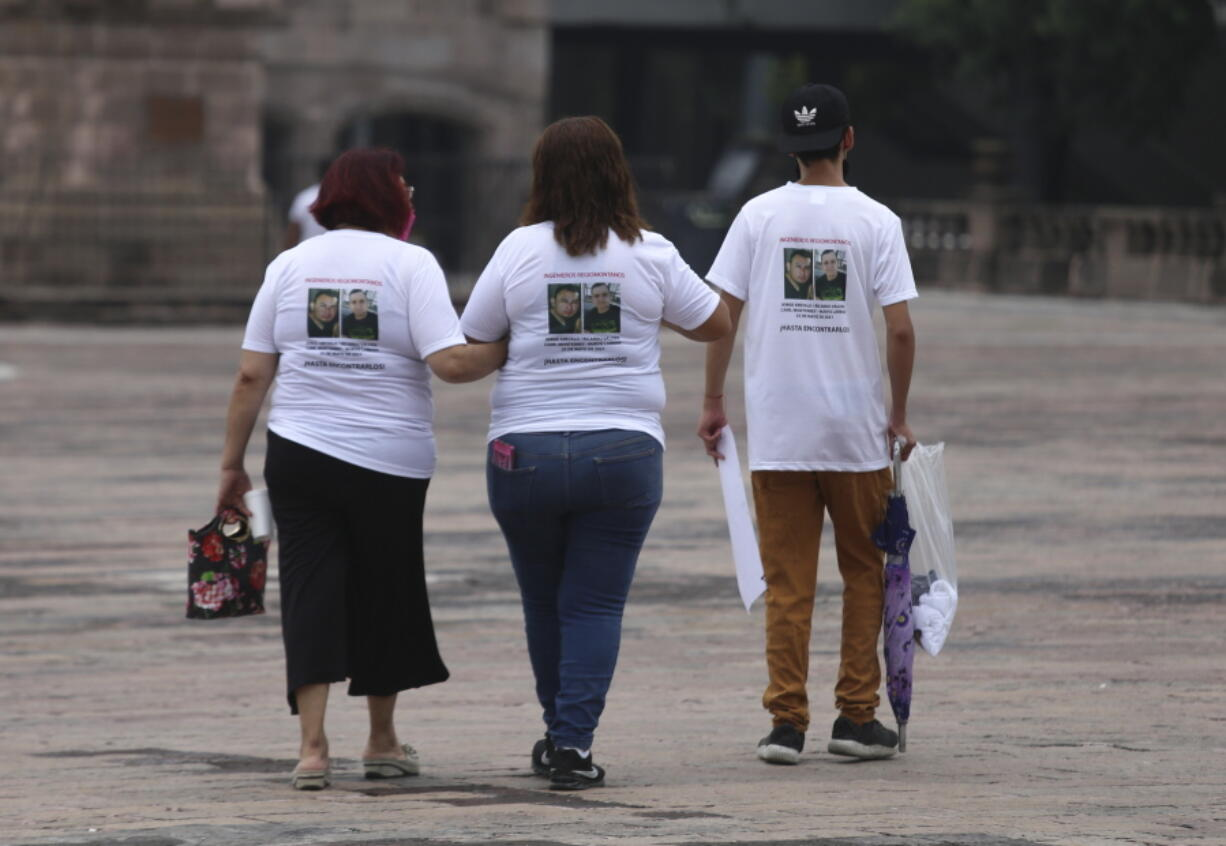 Family members wear T-shirts with photos of disappeared Jorge Arevelo and Ricardo Valdes, during a protest in Monterrey, Nuevo Leon state, Mexico, Thursday, June 24, 2021. As many as 50 people in Mexico are missing after they set off on simple highway trips between the industrial hub of Monterrey and the border city of Nuevo Laredo; relatives say they simply disappeared on the heavily traveled road, which has been dubbed 'the highway of death,' never to be seen again.