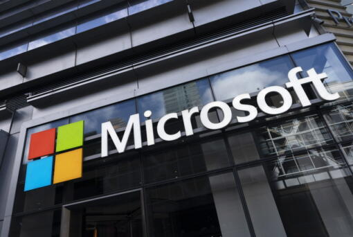 """This May 6, 2021 photo shows a sign for Microsoft offices in New York.  Microsoft has unveiled the next generation of its Windows software, called Windows 11, that has a new """"start menu"""" and other features. The newest version of Microsoft's flagship operating system announced Thursday, June 24,  will be a successor to today's Windows 10, which the company introduced in 2015."""