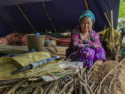 An internally displaced woman sits inside her makeshift tent Thursday at Pu Phar Village, Demawso Township, Kayah State.