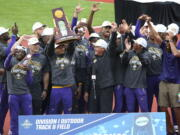 LSU athletes and coach Dennis Shaver, center, celebrate after LSU won the men's team title at the NCAA Outdoor Track and Field Championship in Eugene, Ore., Friday, .June 11, 2021.