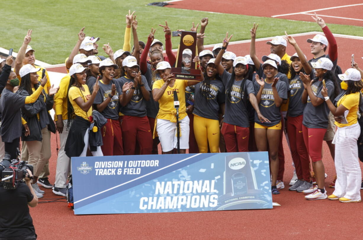 The Southern California women's team accepts the team trophy at the NCAA Division I Outdoor Track and Field Championships, Saturday, June 12, 2021, at Hayward Field in Eugene, Ore.