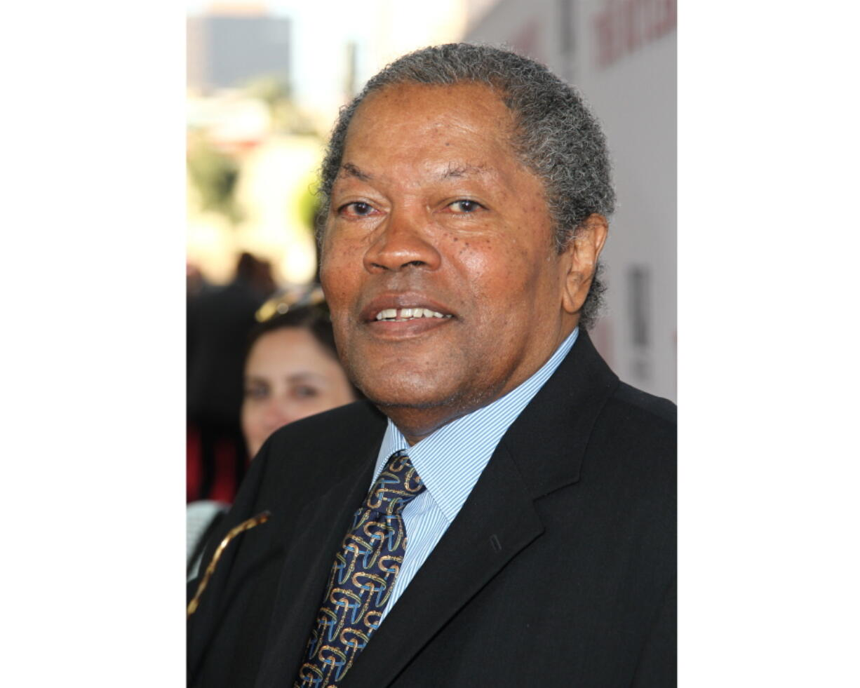 """FILE - In this Aug. 12, 2013 file photo, Clarence Williams III arrives at the Los Angeles premiere of """"Lee Daniels' The Butler"""" at the Regal Cinemas L.A. Live Stadium. Williams died Friday at his home in Los Angeles after a battle with colon cancer, his manager Allan Mindel said Sunday, June 6, 2021. He was 81."""