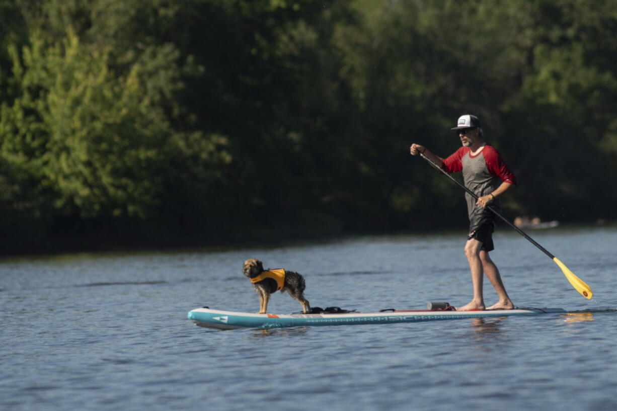 As a heat wave cooked Portland on Friday, June 25, 2021, water-seekers took to the Willamette River for relief. Jet skis, speed boats, paddle-boards, sailors and beachgoers could be seen stretching from the Hawthorne Bridge to the south of Ross Island.