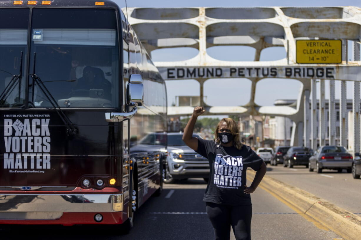 LaTosha Brown, co-founder of Black Voters Matter, stands atop the Edmund Pettus Bridge, a famous civil rights landmark, Saturday, May 8, 2021, in Selma, Ala. Brown was a keynote speaker at the John Lewis Advancement Act Day of Action, a voter education and engagement event held in Selma and Montgomery.